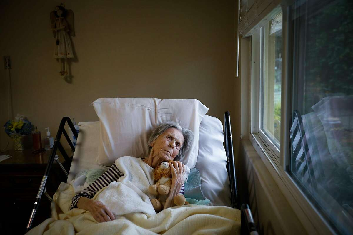 Pat Michelin rests at the Gordon Manor assisted care facility in Redwood City, where vaccines finally arrived.