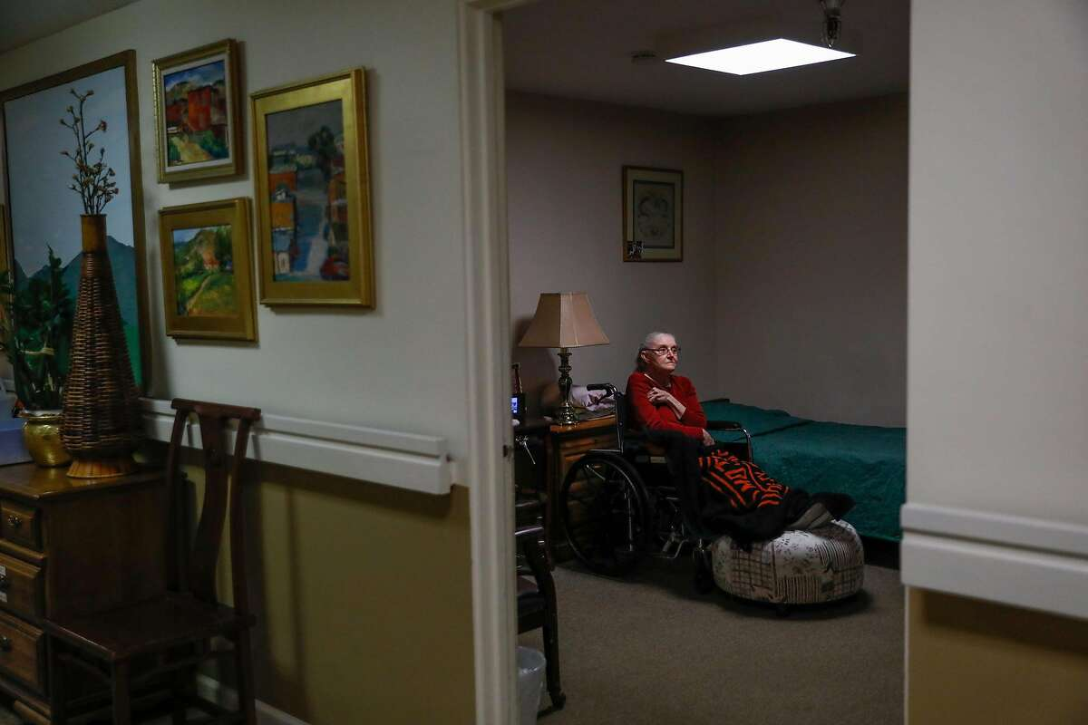 Resident Carol Todd watches television in her room at the Gordon Manor assisted care facility in Redwood City.