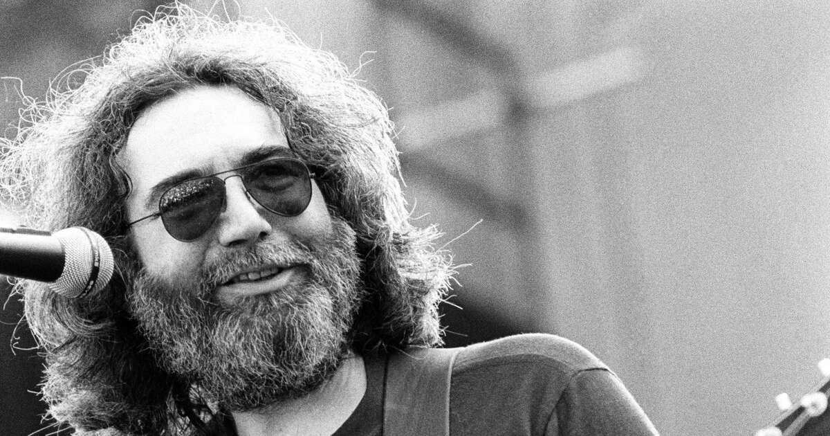 Jerry Garcia performs with the Grateful Dead at the Greek Theater in September, 1981 in Berkeley. (Photo by Ed Perlstein/Redferns/Getty Images)