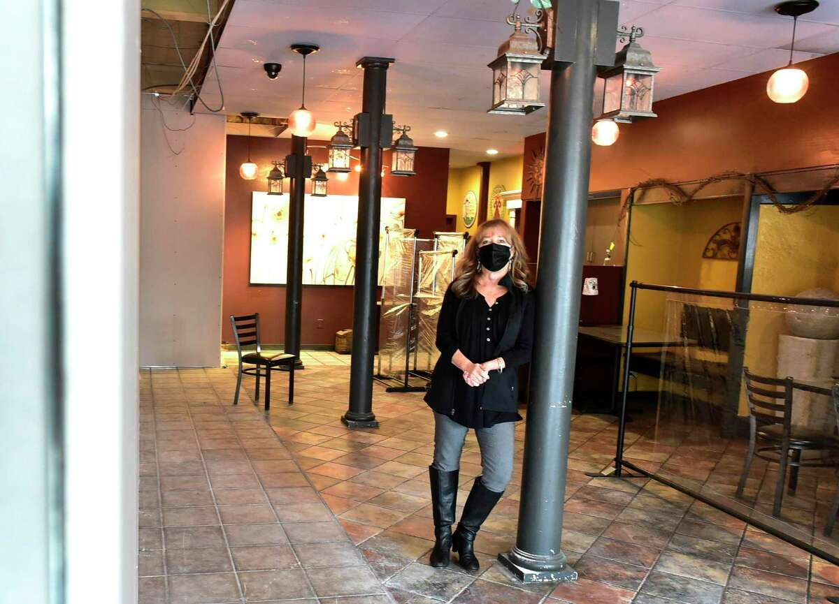 Debbie Pacileo, co-owner of Gaetano's Tavern on Main in Wallingford, stands in the small area of what is left of the gazebo room at the restaurant Jan. 26, 2021.