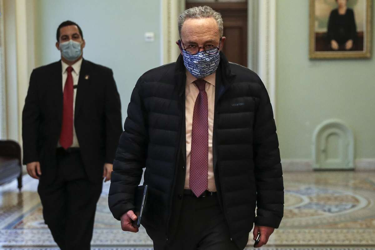 Senate Majority Leader Chuck Schumer (D-N.Y.) walks departs the Capitol in Washington on Wednesday, Jan. 27, 2021. (Oliver Contreras/The New York Times)