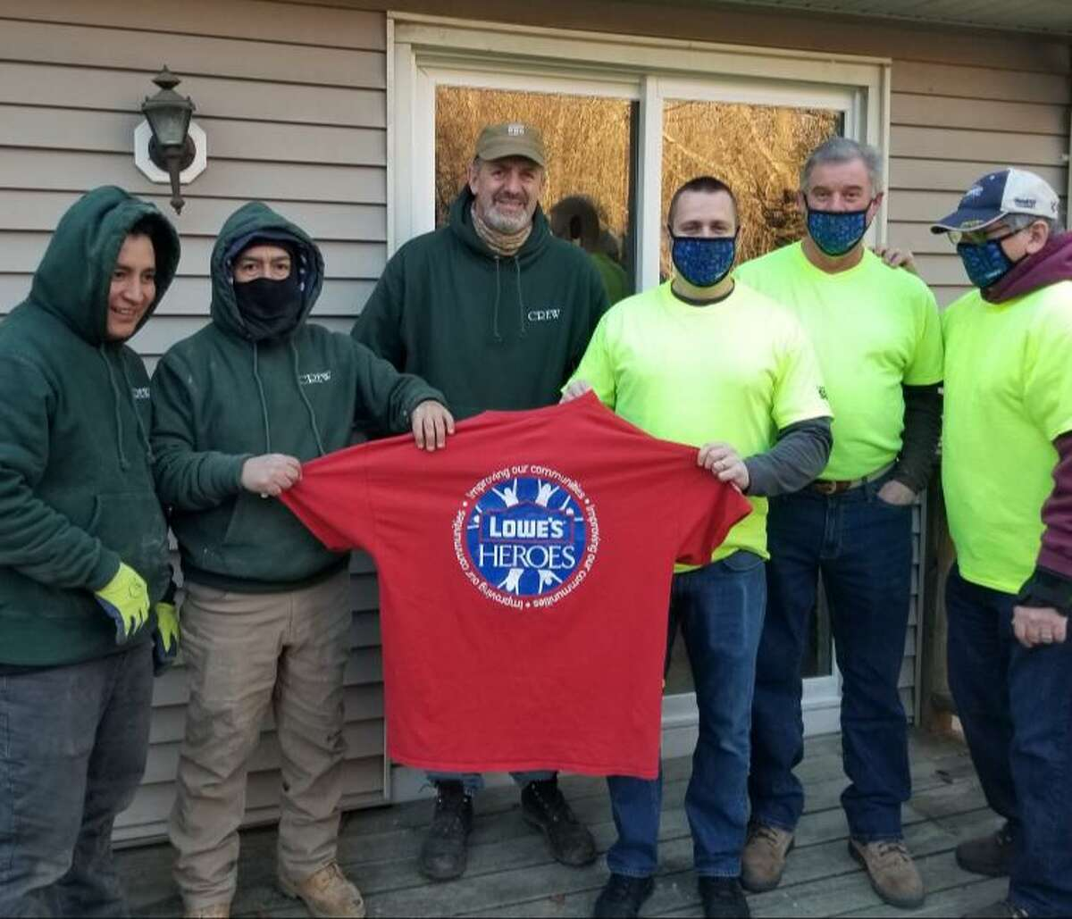 Volunteers recently repaired 90-year-old Bethel resident Julia Herring's home. From left to right: Carlos Javier, Jose Geovanny, Don Bashak, Jeremy Zitofsky, Mike Curley and Bruce Pelaccio. Zitofsky, Curley and Pelaccio are from the LOWES HEROES project in Danbury, while Javier, Geovanny and Bashak are from Don Bashak, LLC.