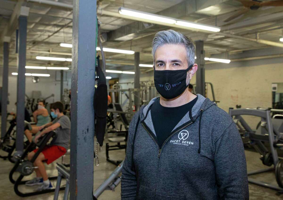 Jose Madrigal, co-owner and group fitness director of Facet Seven Fitness Heights, poses for a photograph at the strength and Olympic lifting area, Wednesday, Jan. 27, 2021, in Houston.