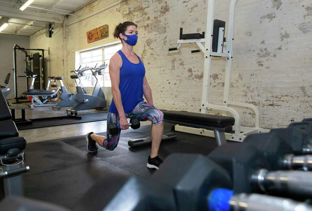 Kelley Devine working out Wednesday, Jan. 27, 2021, at Facet Seven Fitness Heights in Houston. Devine recently renewed her membership, after letting it go for awhile, and just signed up her 18-year-old son, Nate, this year as a birthday gift.