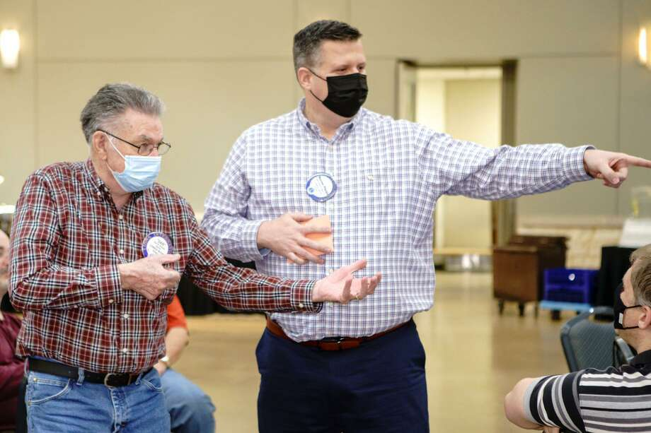 "The Conroe Noon Lions Club hosted a ""Shake it Up"" meeting at their luncheon last Wednesday and members participated in a rousing game of 'charades'. Pictured: (l-r) Lions Dan Grimes and Warner Phelps. Photo: Courtesy Photo"