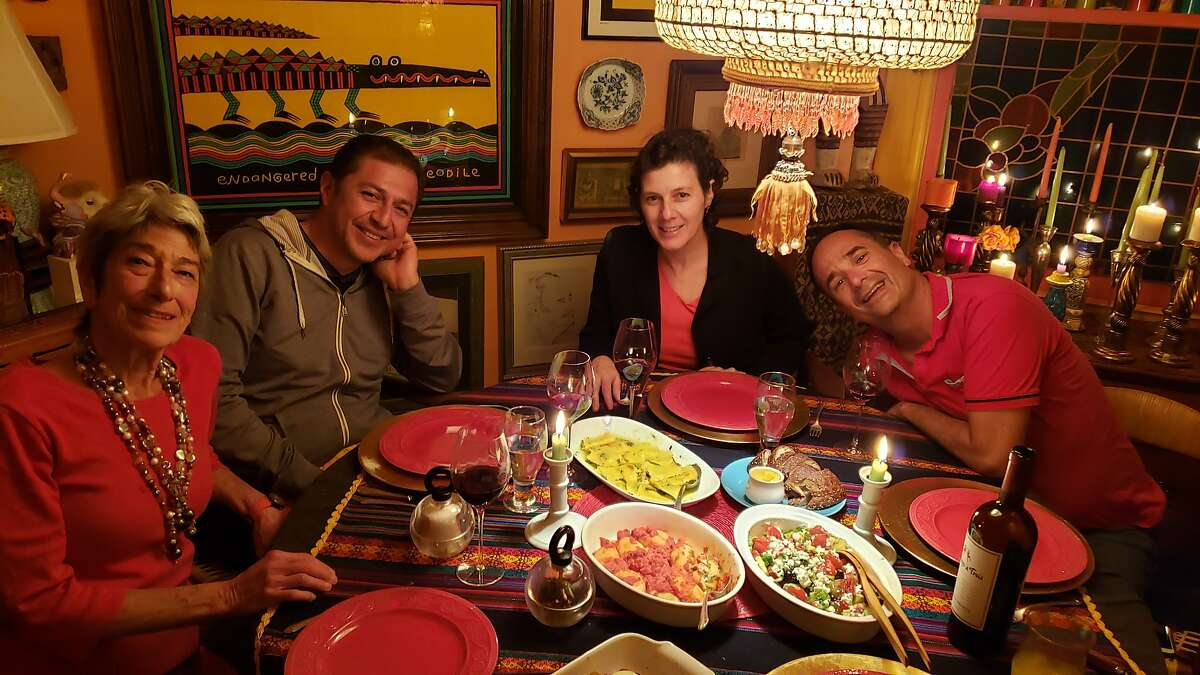 """Jorge Sanchez packed his days full of time with friends. Here, from left to right, Constance Bernstein, Juan Carlos Guerrero, Maria Leticia Gomez, Jorge Sanchez enjoy a dinner party at Bernstein's home in San Francisco in October 2019. Sanchez's partner, Jose """"Miguel"""" Vazquez took the picture."""