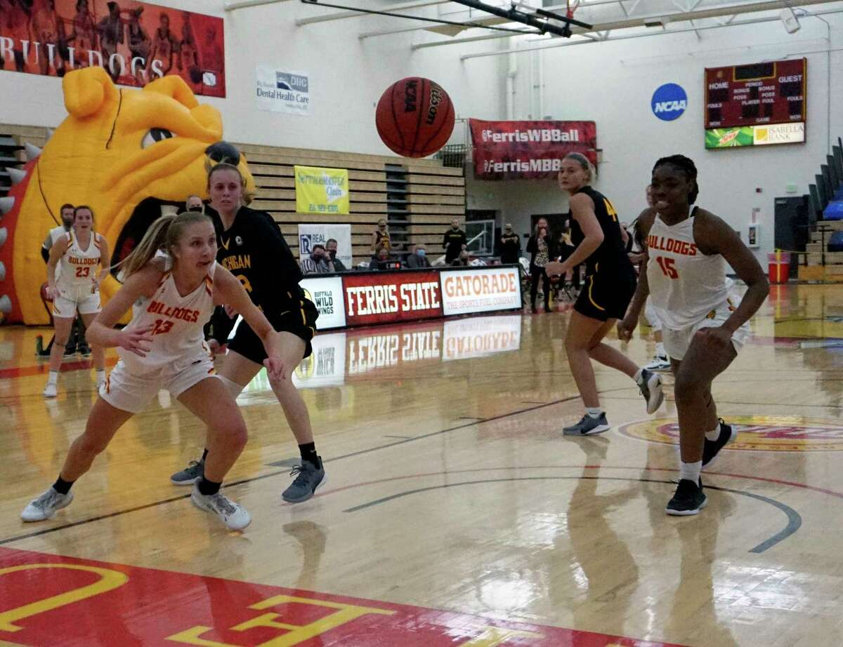 Ellie Dykstra (left) and Ariel Jenkins (right) of Ferris State make a move for the ball during Ferris' loss against Michigan Tech on Friday night at Wink Arena. (Pioneer photo/Joe Judd)