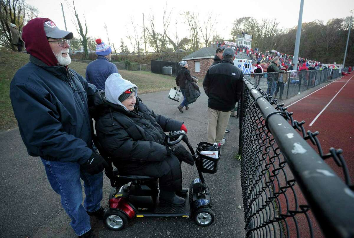 John and Louise Wells of Greenwich watch the opening kick off between Ridgefield and Greenwich of a high school football game at Cardinal Stadium on Nov. 16, 2019. The new bleachers and other stadium improvements are designed to help address the accessibility issues that make it so difficult for people with disabilities.
