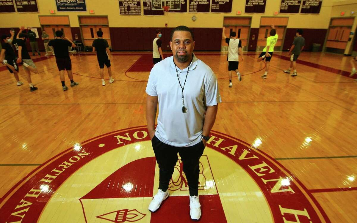 North Haven High's basketball Head Coach Danny Oglesby poses during practice at the school in North Haven, Conn., on Thursday Jan. 28, 2021.