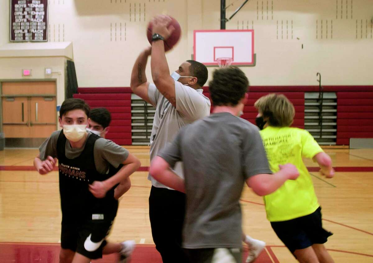 North Haven High's basketball Head Coach Danny Oglesby leads the boys team in practice at the school in North Haven, Conn., on Thursday Jan. 28, 2021.