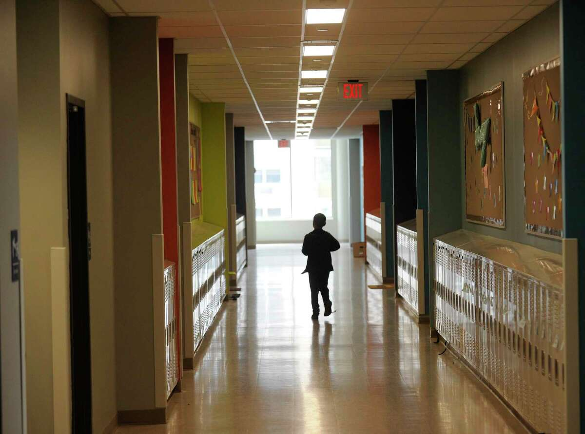 Student walks in the hallway at Strawberry Hill School on Sept. 5, 2019 in Stamford, Connecticut.