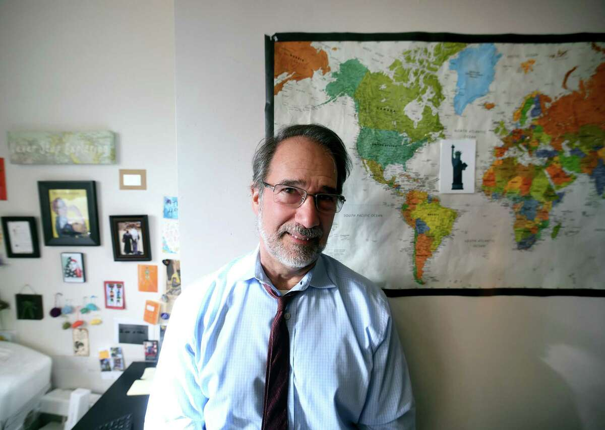 Chris George, executive director of Integrated Refugee & Immigrant Services, is photographed in their New Haven offices in 2017.