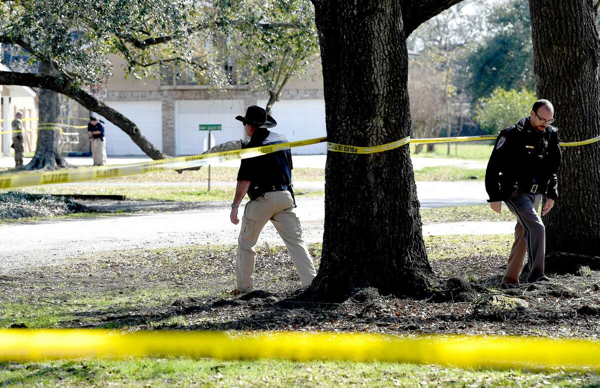 Orange County Sheriff officers and detectives continue their investigation at the scene of a double shooting that occured Friday near Bridge City. Photo taken Friday, January 29, 2021 Kim Brent/The Enterprise