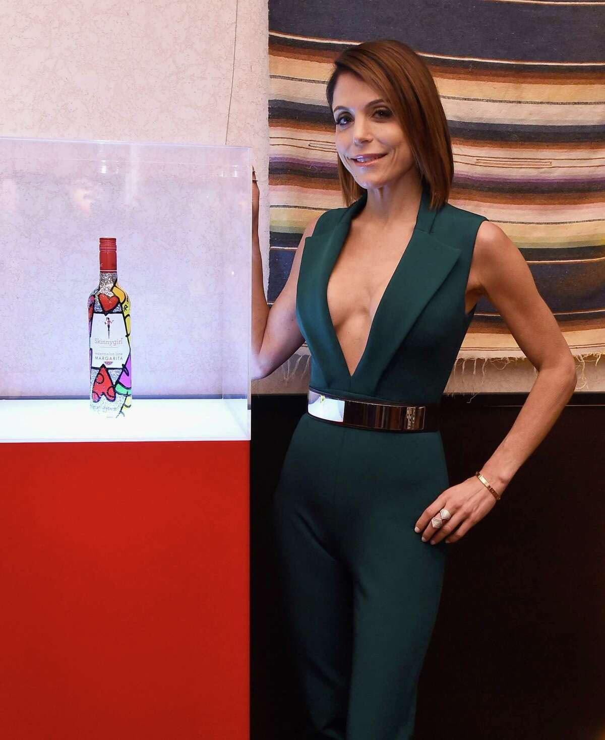 Bethenny Frankel attends a Mexican Fiesta where she shares a sneak peek of the newest addition to Skinnygirl Cocktails' line of more than 20 offerings. To commemorate the launch, close friend and world-renowned pop artist Romero Britto presents her with a personally designed, one-of-kind bottle at Astor Place on March 3, 2016 in New York City.