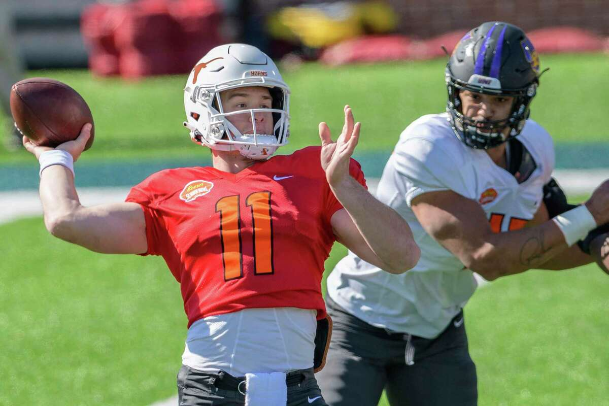Sam Ehlinger of Texas (11) throws during practice for the Senior Bowl college football game in Mobile, Ala.