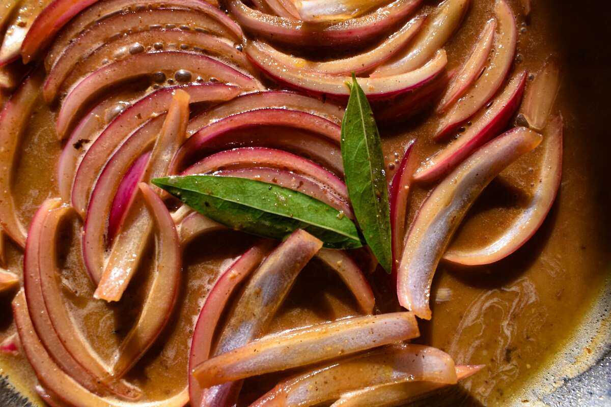 Extra salted pickled red onions add a fuchsia hue and a slight crunch.