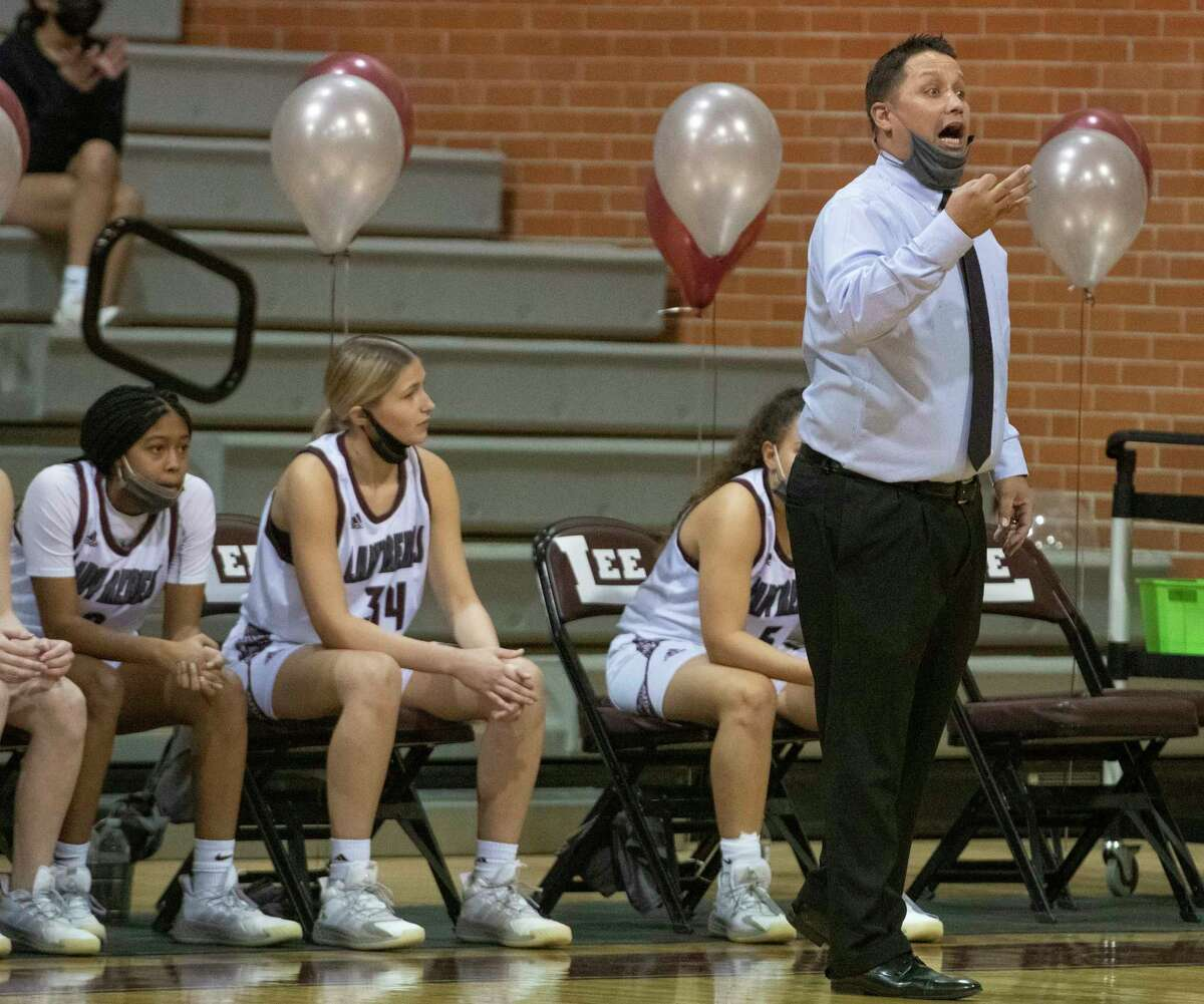 Lee High girls basketball coach Alfred Acosta encourages his players as they battle Midland High 01/29/2021 at the Lee High gym. Tim Fischer/Reporter-Telegram