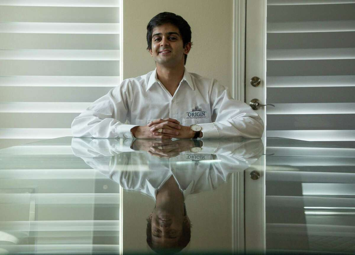 Saif Maknojia, 24, owner of Origin Roofing and Metal, poses for a photograph inside his home Friday, Jan. 29, 2021, in Sugar Land, Texas. Maknojia was one of many who invested in GameStop stock.