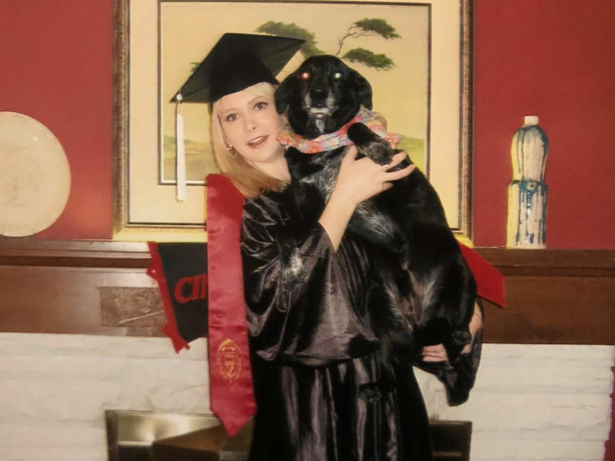 The author and Ember before her college graduation.
