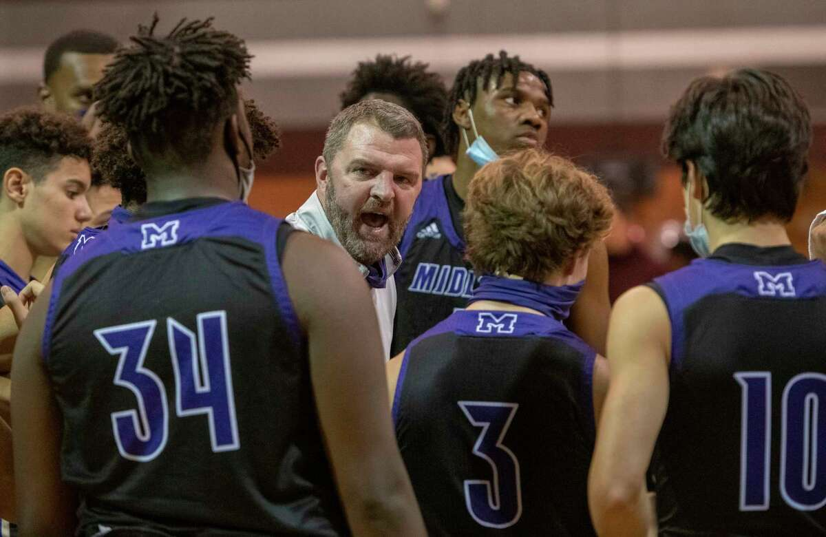 Midland High Coach Dustin Faught talks with his players during a timeout as they battle Lee High 01/29/2021 at the Lee High gym. Tim Fischer/Reporter-Telegram