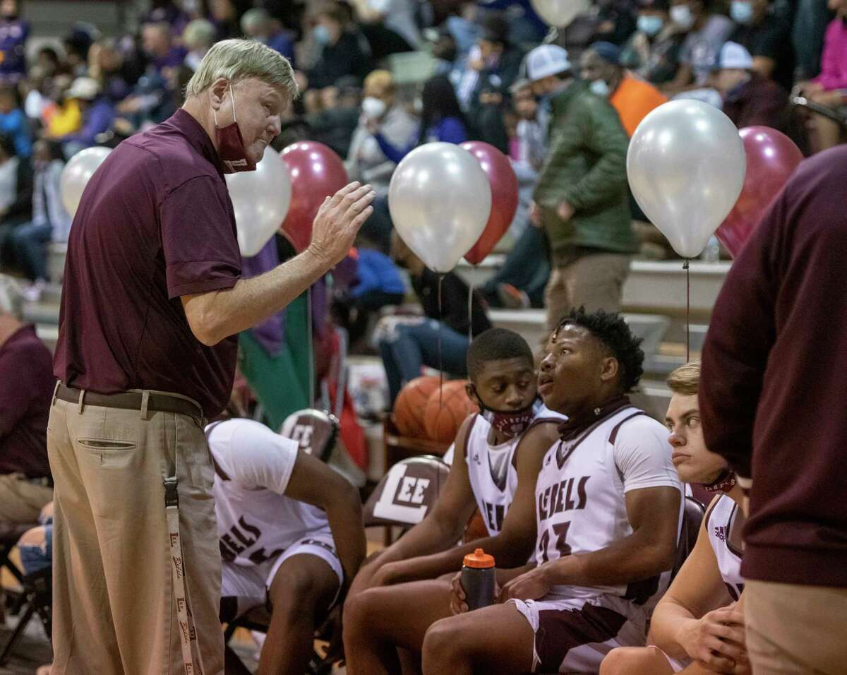 Lee High Coach Doug Gordon talks with his players as they battle Midland High 01/29/2021 at the Lee High gym. Tim Fischer/Reporter-Telegram