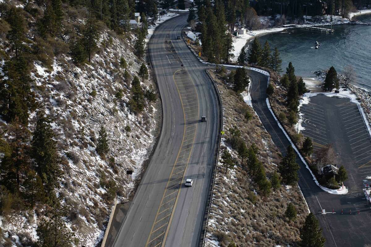 BEFORE: Motorists on Highway 50 drive toward South Lake Tahoe, Calif., before a large winter storm arrives on Jan. 26, 2021.