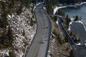 Motorists on Highway 50 drive towards South Lake Tahoe, Calif. before a large winter storm arrives on Jan. 26, 2021.