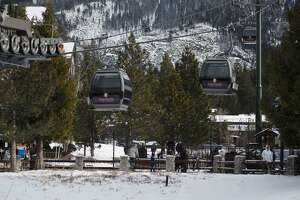 The Heavenly Gondola shuttles passengers up to the resort's peak on Jan. 26, 2021 before a large winter storm arrives in South Lake Tahoe, Calif. High winds threaten to shut down certain mountain operations such as the gondola and other lifts.