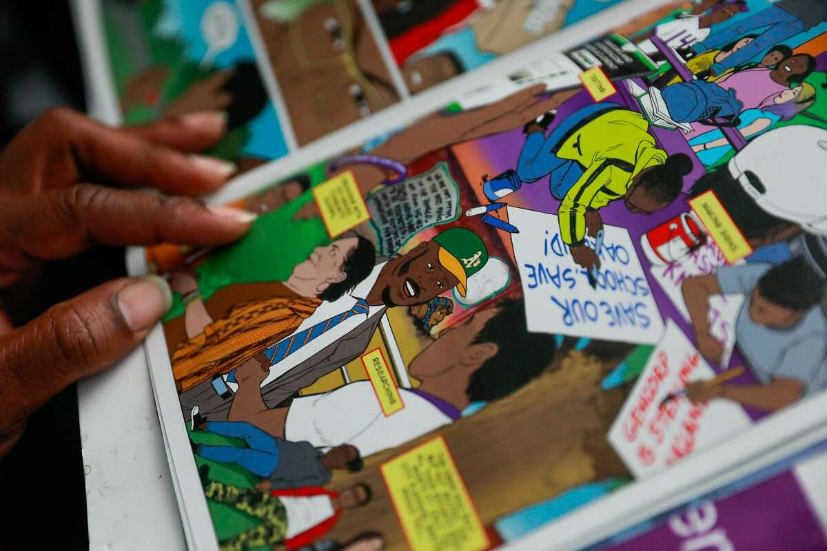 A comic book is one teaching tool that Oakland resident John Jones III employs to encourage son Josiah's enthusiasm about Black history.