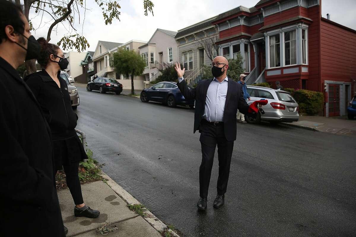 District Eight Supervisor Rafael Mandelman talks with neighborhood residents Hilary and Mike Schiraldi in the Glen Park area of San Francisco.