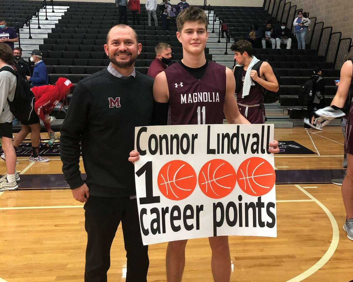 Magnolia senior Connor Lindvall, shown here with head coach Derek Cain (left), reached 1,000 career points in Friday's win over College Station.