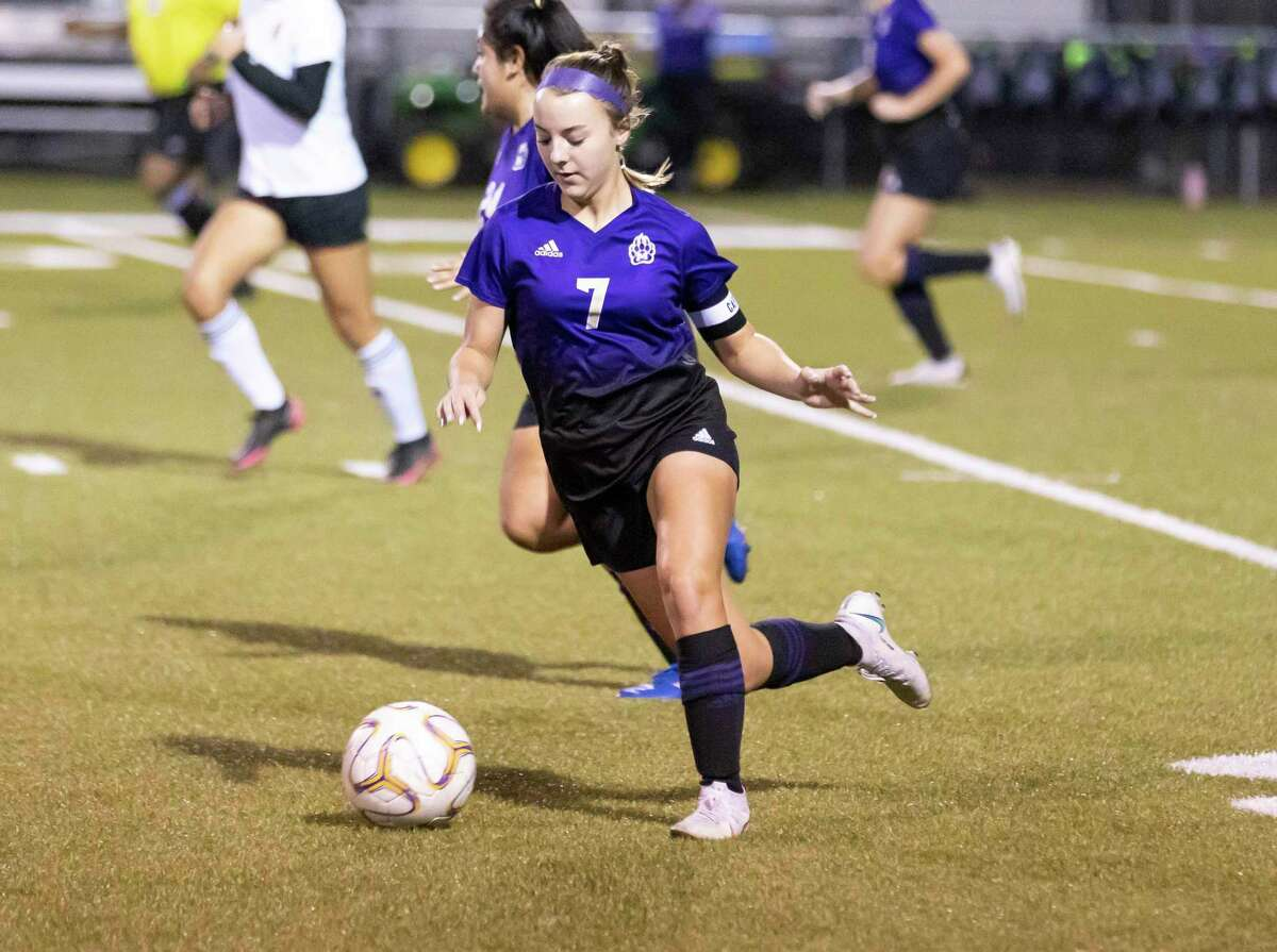 Montgomery defensive midfielder Makenzie Griffith (7) drives the ball during the first period of a District 20-5A girls high school soccer match against Caney Creek at Montgomery High School, Tuesday, Jan. 26, 2021, in Montgomery.