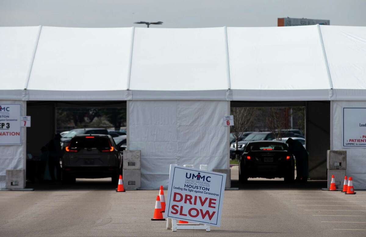 Motorists who made appointments wait to receive the COVID-19 Moderna vaccine at the drive through site at Delmar Stadium on Friday, Jan. 29, 2021, in Houston. The site is operated in a partnership between the city and United Memorial Medical Center.