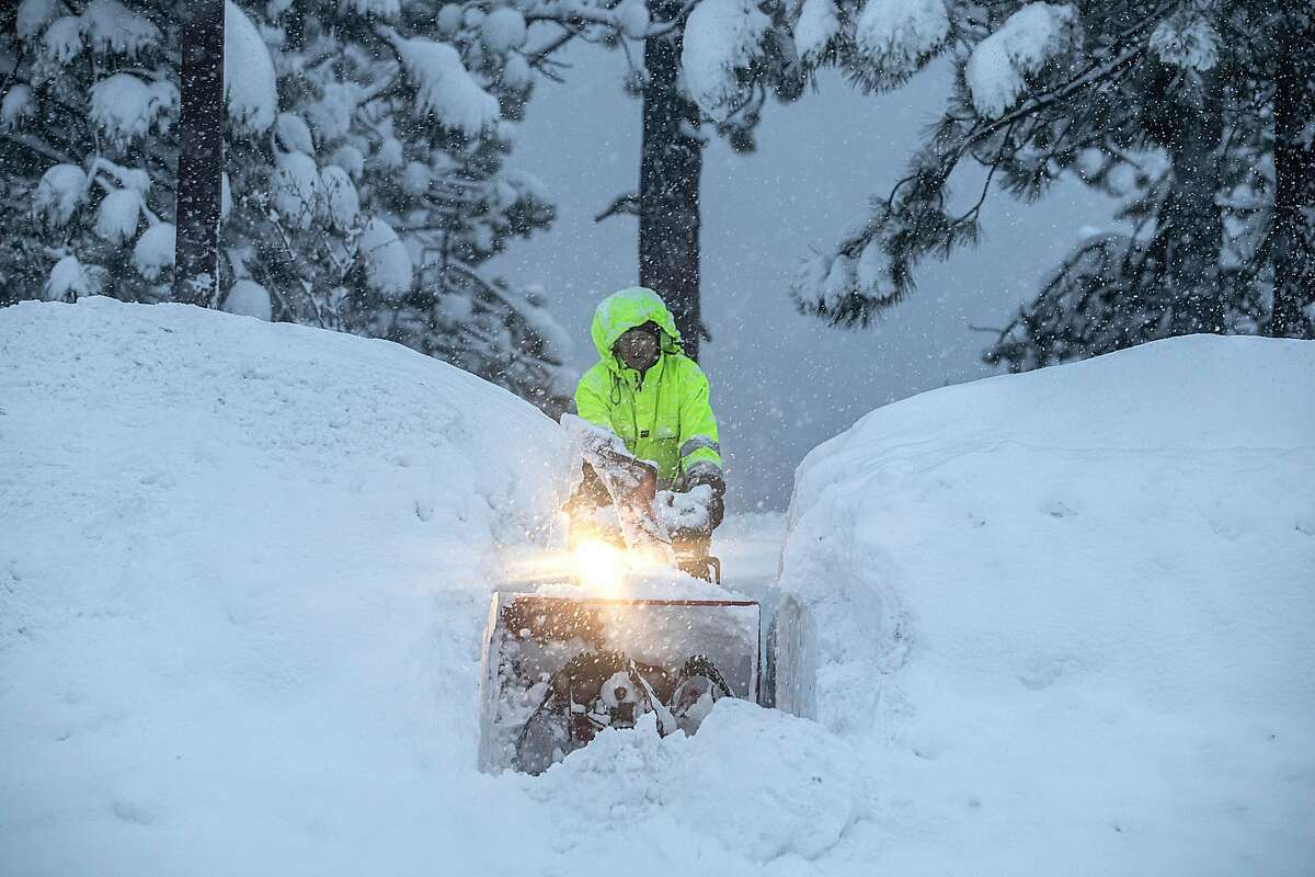 People dig out of the snow during a winter snowstorm in Tahoe City, Calif. on Jan. 28, 2021.