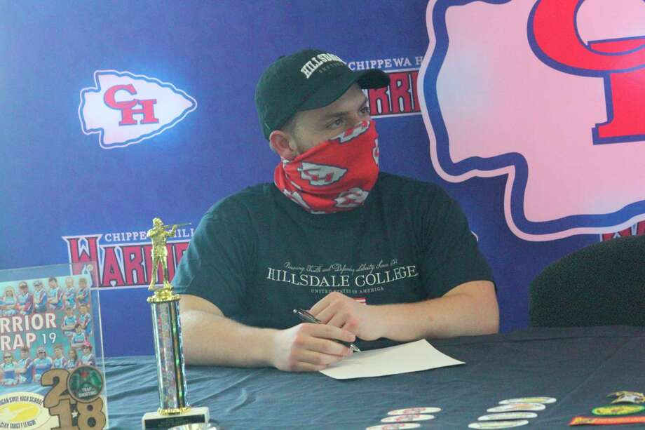 Jonathan Calabrese gets ready on Thursday to sign his national letter of intent with Hillsdale College. (Pioneer photo/John Raffel)