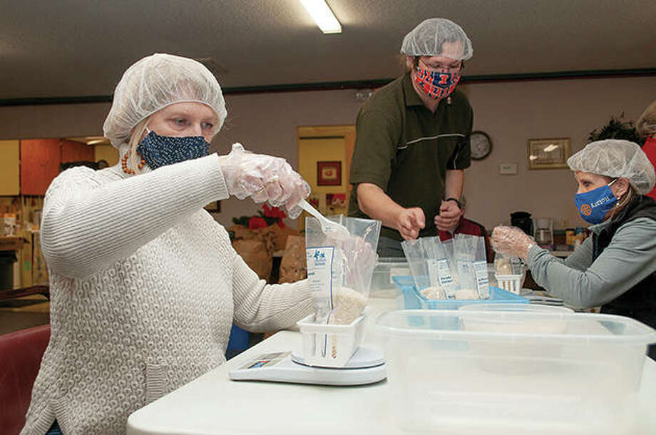 Jacksonville Rotarians package bags of rice, dry vegetables and protein powder Friday at Calvary Baptist Church at 859 N. Main St. Jacksonville Noon Rotary Club contributed $1,200 to package 4,320 meals for the organization Feeding Children Worldwide, which will distribute the meals internationally. Photo: Darren Iozia   Journal-Courier