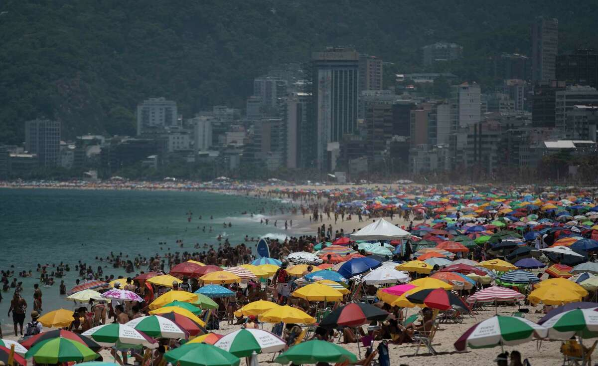 People fill Ipanema beach in Rio de Janeiro, Brazil, Friday, Jan. 29, 2021, amid the COVID-19 pandemic.
