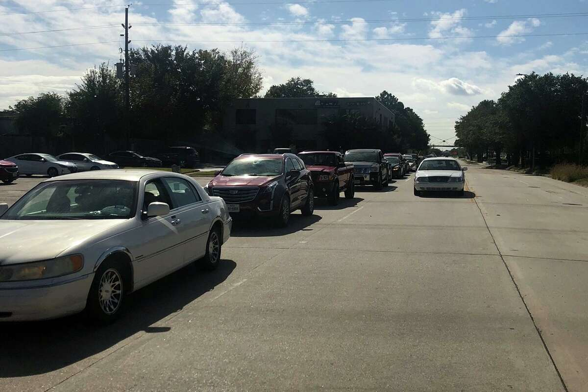 Lone Star College-Houston North conducted a series of food drives to help families during the holiday season. Pictured are cars lined up where LSC-Houston North provided 768 families with food.