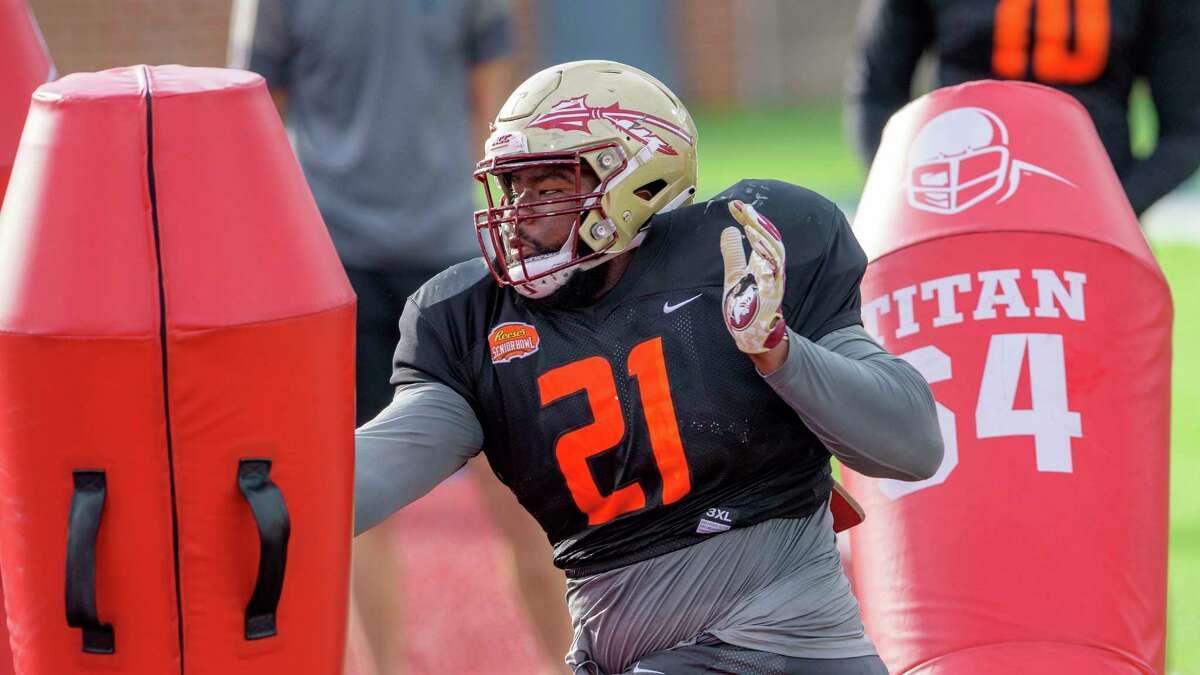 American Team defensive lineman Marvin Wilson of Florida State (21) runs a drill during the American Team practice for the NCAA Senior Bowl college football game in Mobile, Ala. Wednesday, Jan. 27, 2021. (AP Photo/Matthew Hinton)
