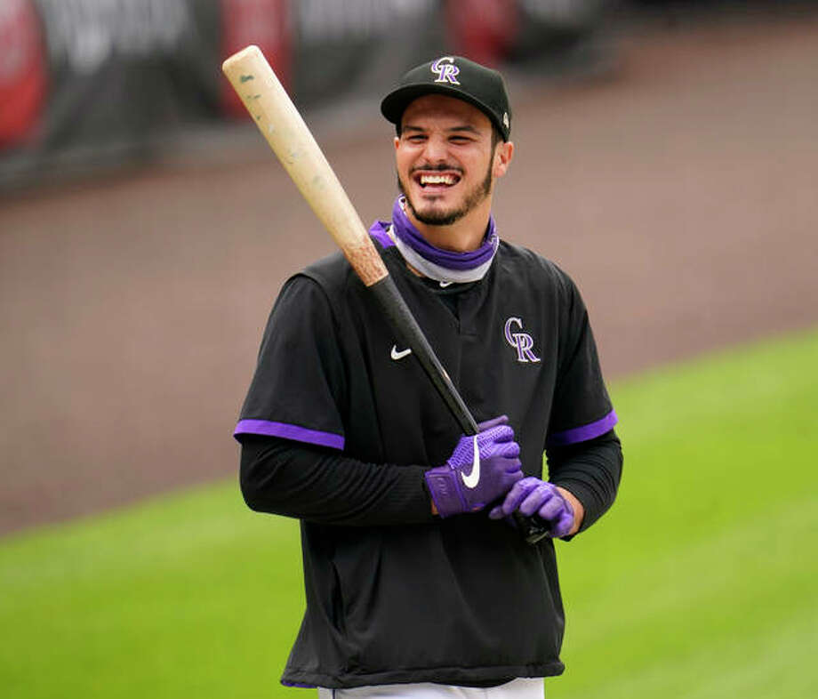 Colorado Rockies third baseman Nolan Arenado warms up before a game last September in Denver. Arenado was traded to the St. Louis Cardinals on Friday. Photo: Associated Press