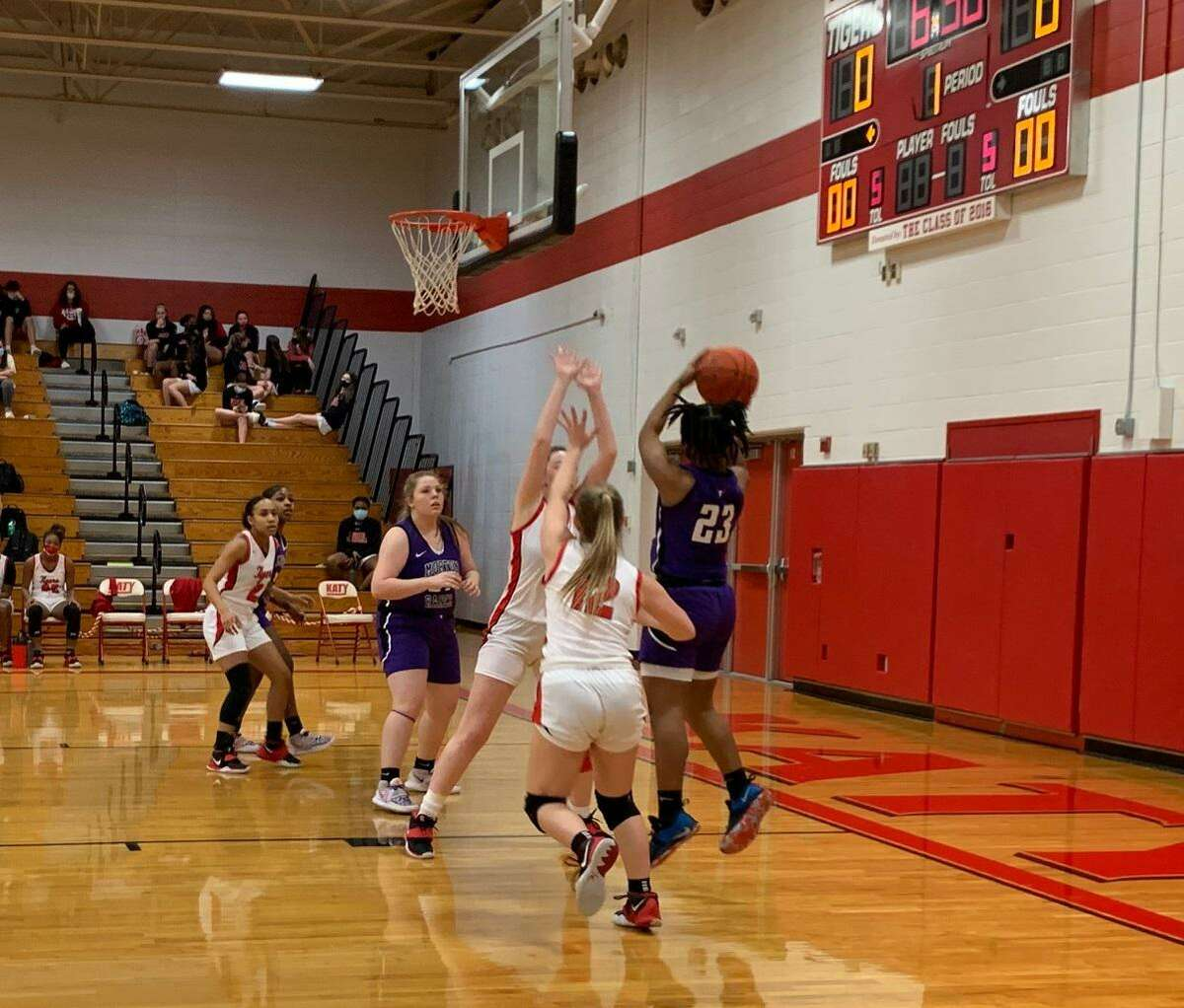 Morton Ranch's A'lyvia Jackson shoots over defenders during a District 19-6A game against Katy, Jan. 29 at Katy High School.