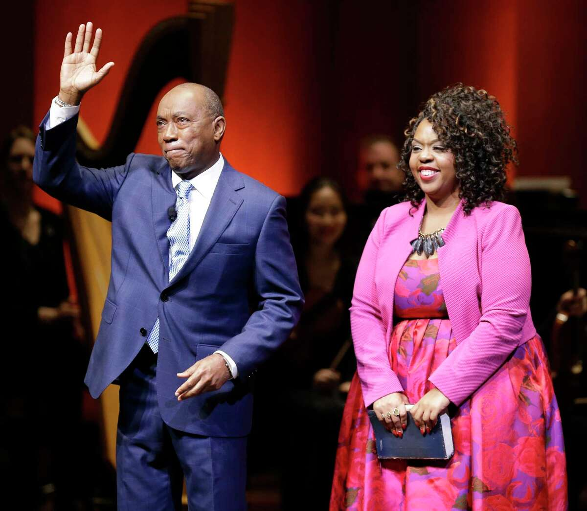 Mayor Sylvester Turner with his daughter Ashley Turner waves after being sworn in by Judge Vanese Gilmore during the 2016 Elected Officials Inauguration Ceremony at the Jesse H. Jones Hall for the Performing Arts, Monday, Jan. 4, 2016, in Houston.