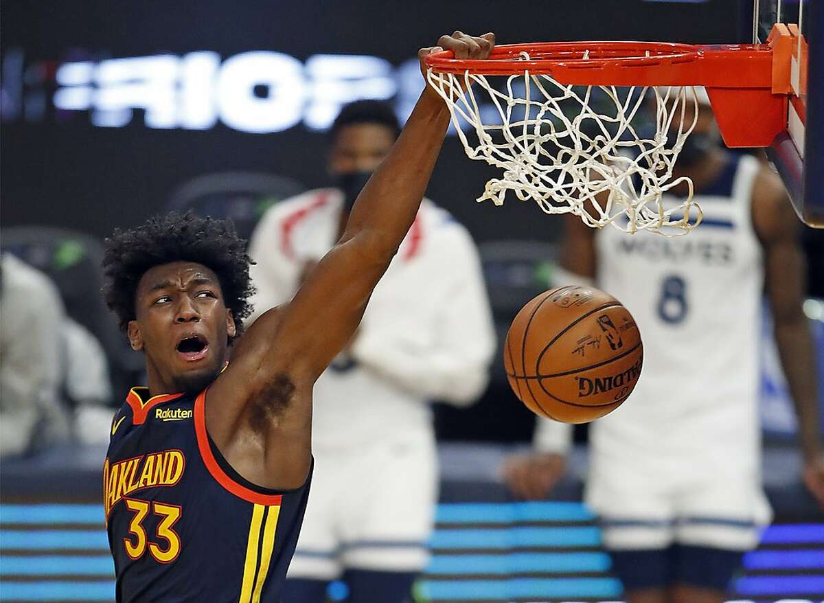 Golden State Warriors' James Wiseman dunks for 2 of his 25 points against Minnesota Timberwolves in 4th quarter of Warriors' 123-111 win during NBA game at Chase Center in San Francisco, Calif., on Wednesday, January 27, 2021.