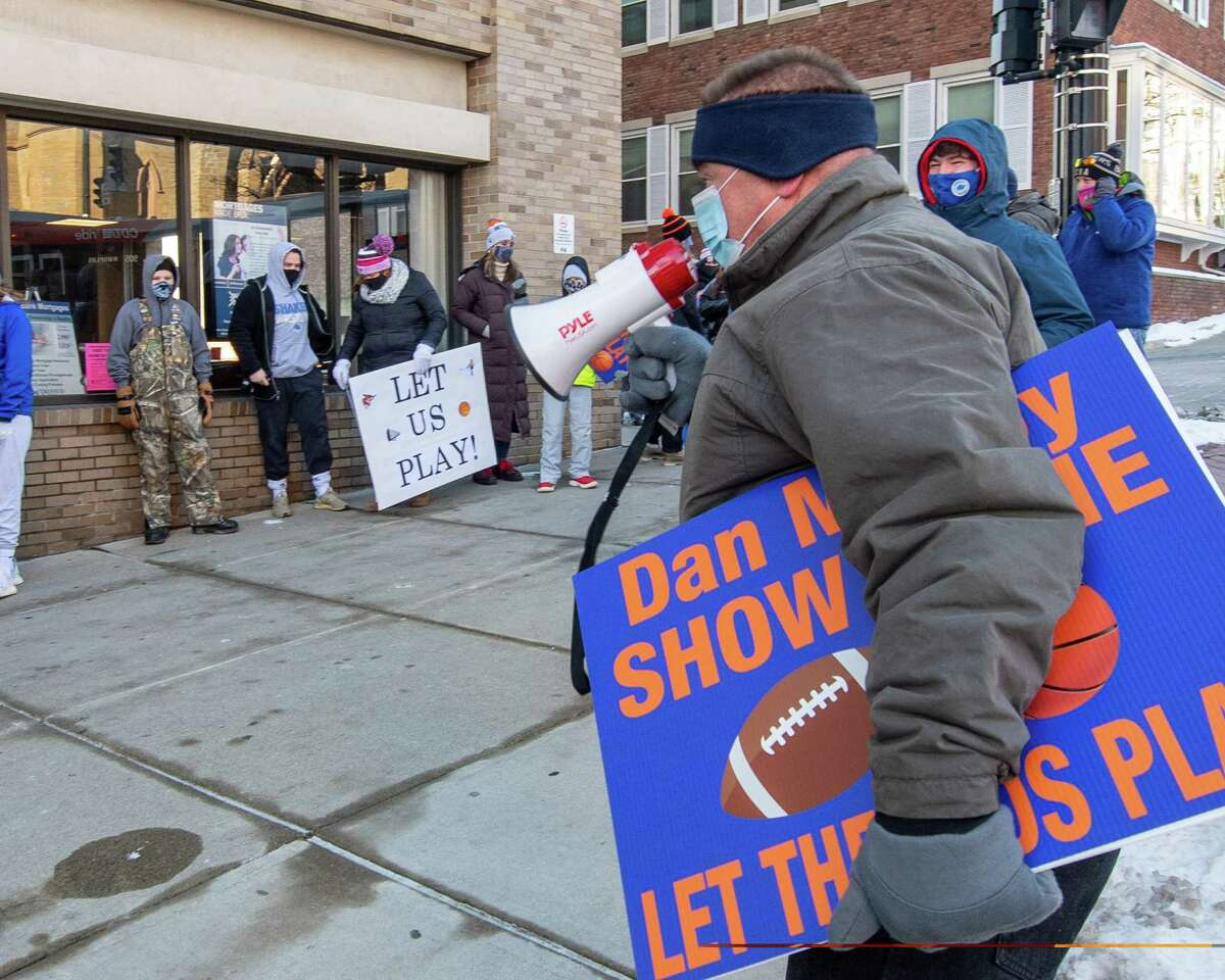 Paul Schafer, of Latham, and parent of Shaker High students uses a bullhorn to talk to athletes, parents and coaches who gathered outside the Albany County office building on State Street on Saturday, Jan.29, 2021, calling on County Executive Dan McCoy to allow so-called high risk sports to begin on Feb. 1 (Jim Franco/special to the Times Union.)