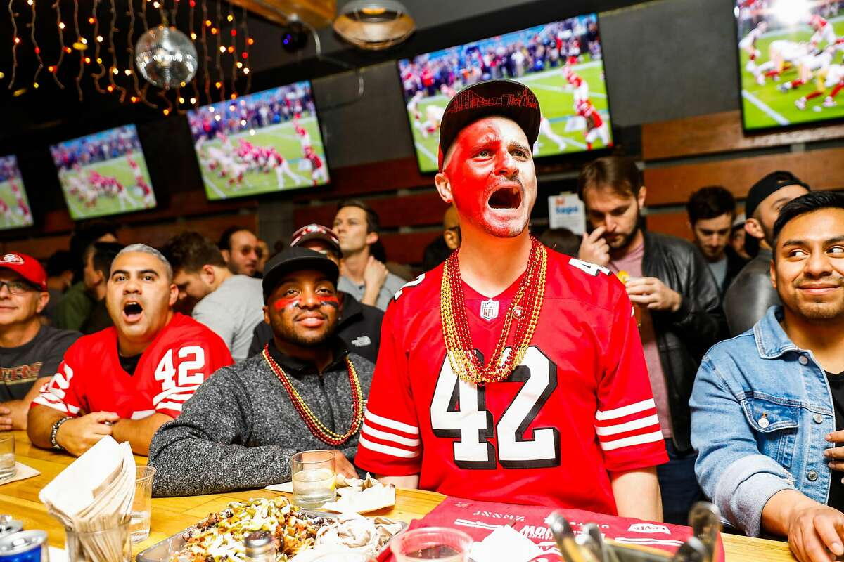 San Francisco 49ers fan Gary Heimeyer (center) cheers at Hi Tops bar in S.F. during the first half of the Super Bowl between the 49ers and the Kansas City Chiefs in February 2020. Health authorities are warning against Super Bowl gatherings this year.