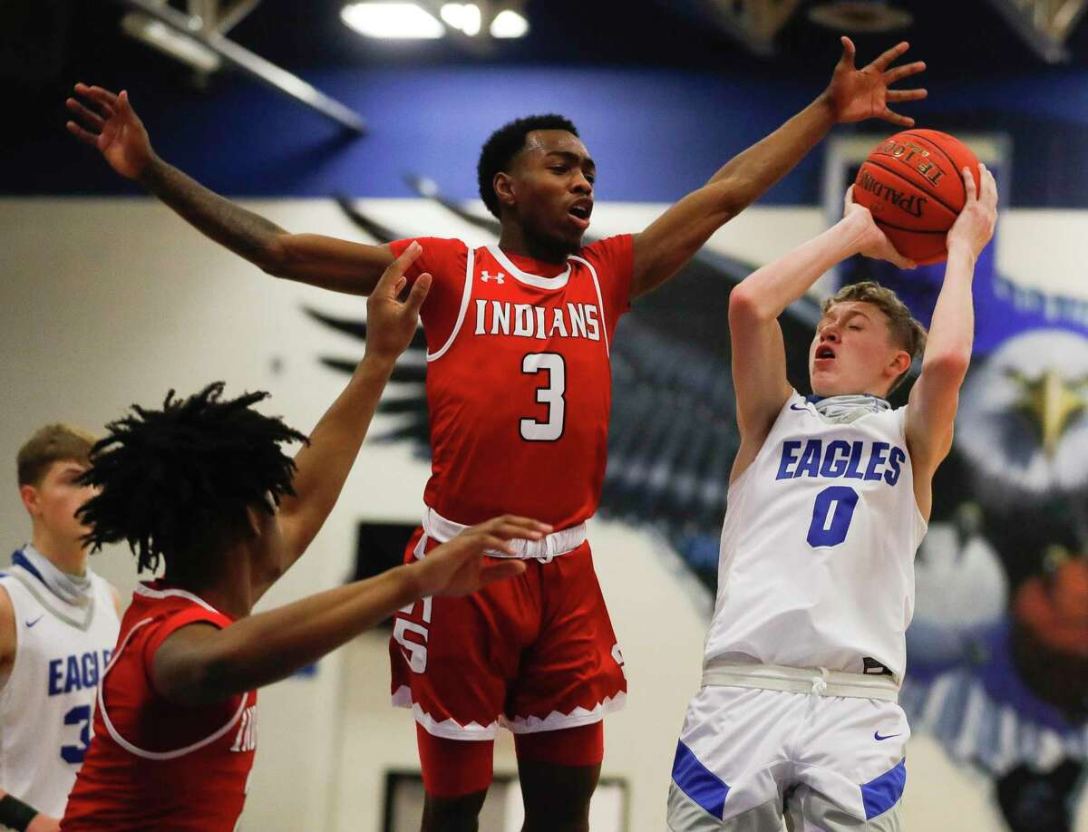 New Caney shooting guard Jaxon Olvera (0) scored 17 points as the Eagles topped Cleveland, 58-47.