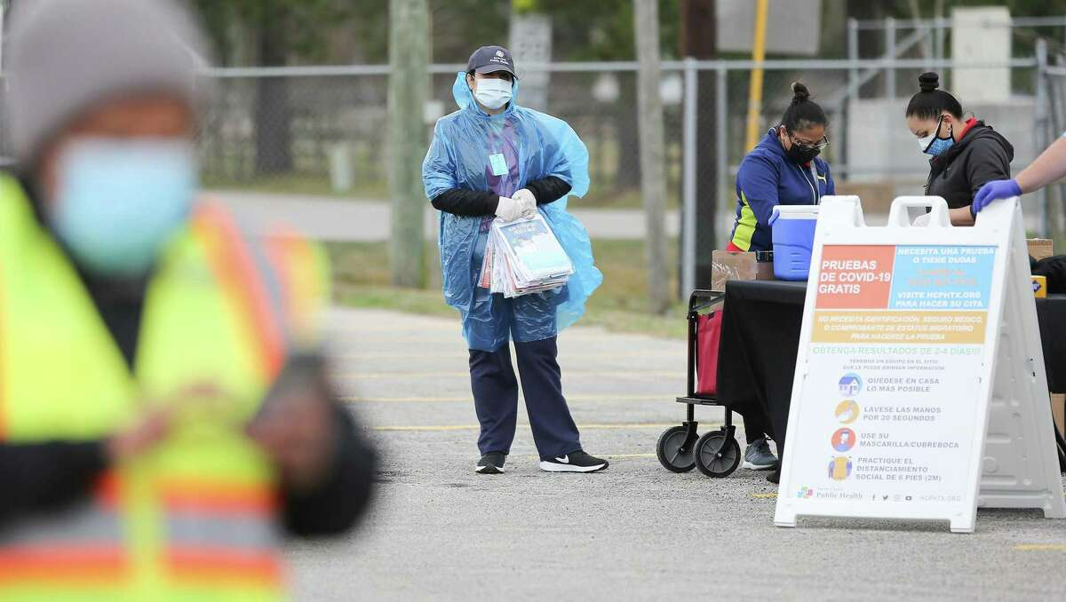 Volunteers get ready to distribute PPE's and COVID-19 information at a temporary COVID testing and food distribution site at Pep Mueller Community Center in Houston on Saturday, Jan. 30, 2021.