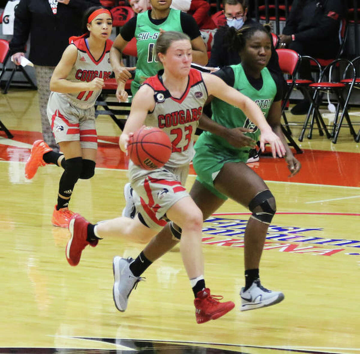 SIUE's Allie Troeckler (23) pushes the ball upcourt while teammate Mikia Keith (left) trails the play during a Dec. 21 game against Chicago State at First Community Arena in Edwardsville. The Cougars were on the road Saturday and lost at Tennessee-Martin 79-45.
