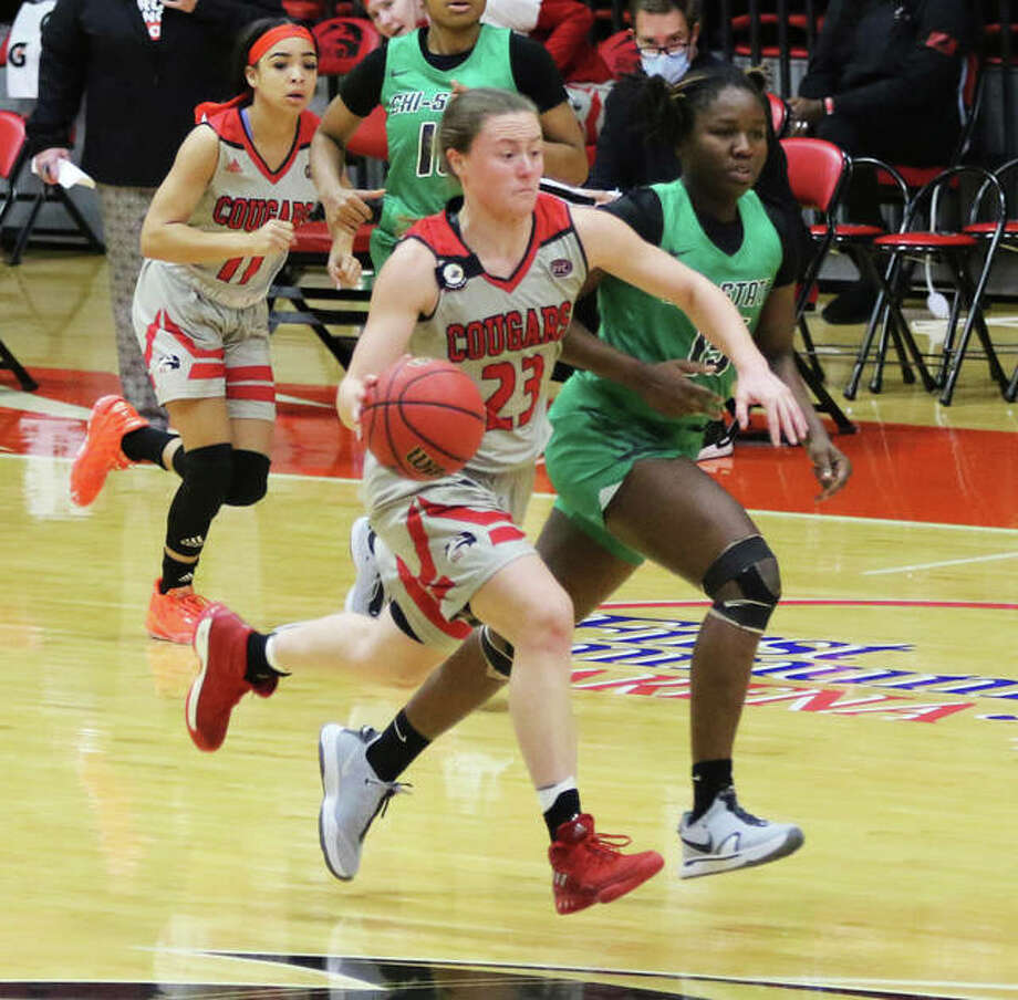 SIUE's Allie Troeckler (23) pushes the ball upcourt while teammate Mikia Keith (left) trails the play during a Dec. 21 game against Chicago State at First Community Arena in Edwardsville. The Cougars were on the road Saturday and lost at Tennessee-Martin 79-45. Photo: Greg Shashack / The Telegraph