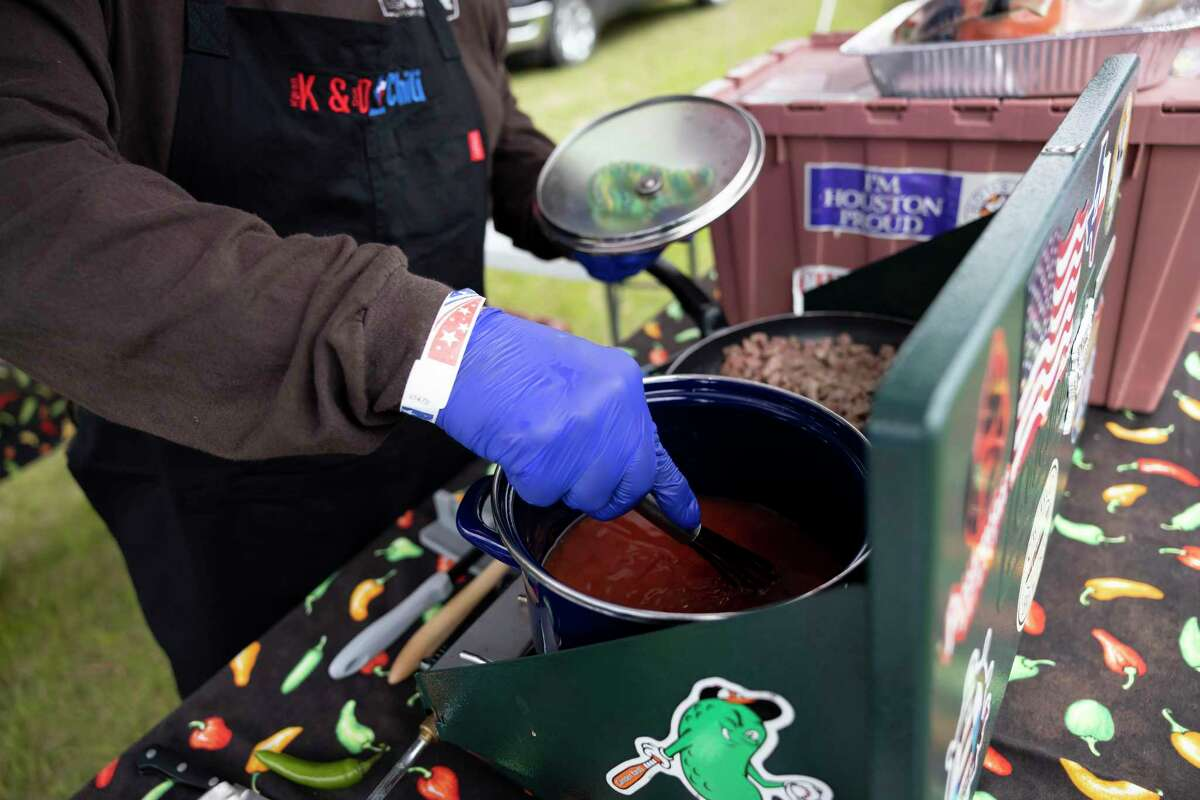 Don Cullum with K&D Chili prepares his specialty chili during a chili cookoff hosted by Boots For Troops, Saturday, Jan. 30, 2021, in Magnolia. Cullum, along with his wife Karen, travel around the country competing in chili competitions where they've placed numerous times.